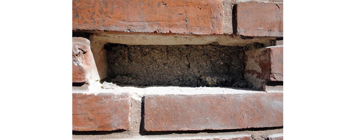 udtagning af sten til hulmursisolering